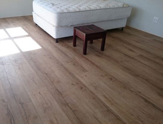 wood-flooring-with-bed-and-coffee-table
